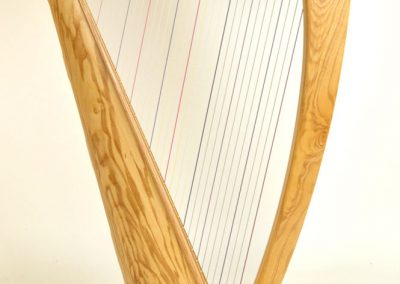 Side view of a Telynau Teifi 34-string Telor folk lever harp in ash