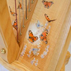 Harp soundboard decoration with handpainted butterflies