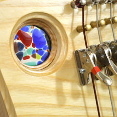 Harp with coloured stained glass porthole