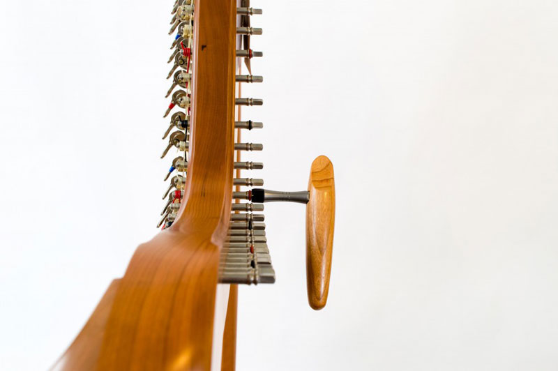 A harp tuning key attached to a harp