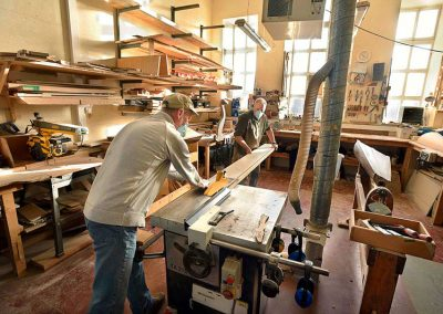 The harpmaking lads busy in the wood workshop