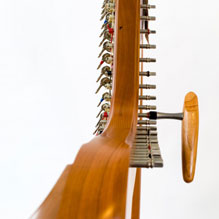 Tuning key on harp tuning pins ready for tuning