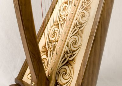 Eos harp featuring Celtic knotwork done by pyrography