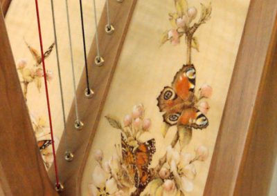 Eos harp soundboard with handpainted butterflies