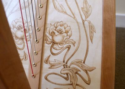 Eos harp soundboard with flowers pyrography