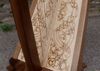 Eos harp soundboard with Celtic knotwork pyrography