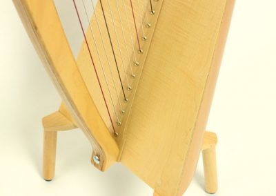 Leg view of a Siff Saff lever harp in beech