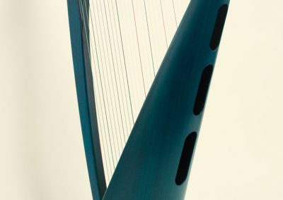 Back view of a Siff Saff lever harp in electric blue