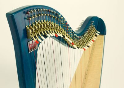 Neck view of a Siff Saff lever harp in electric blue
