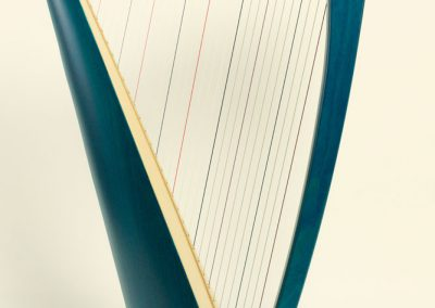 Side view of a Siff Saff lever harp in electric blue