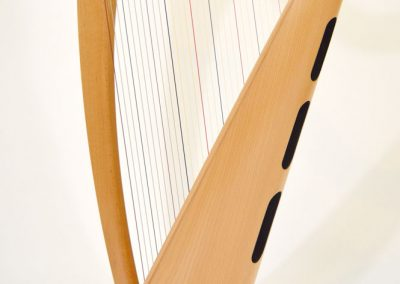 Side view of a Telynau Teifi 34-string Telor folk lever harp in beech