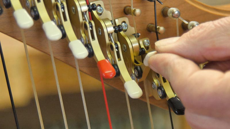 Harp semitone levers being changed